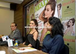 amyjackson unveils the cover of a healthandnutritionmagazine