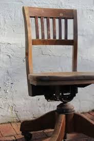 wooden rolling desk chair antique bankers oak rolling desk chair 1920s wood casters library