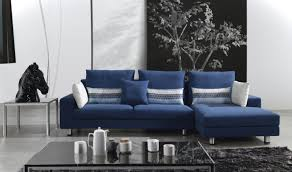 be inspired by a living room anchored by a bold blue sofa living