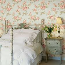 country style bedroom decorated with floral wallpaper and flower