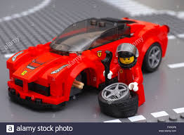 lego speed champions ferrari lego driver minifigure is fixing wheel of laferrari by lego speed