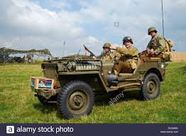willys army jeep men posing in ww2 us army uniforms in a 1943 willys mb jeep