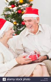 elderly gifts elderly exchanging christmas gifts stock photo 66956125