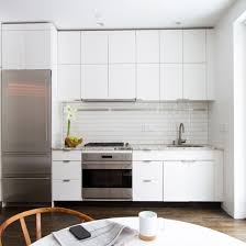 interior amazing white kitchen cabinets with fasade backsplash white kitchen cabinets the perfect backdrop for a chic decor