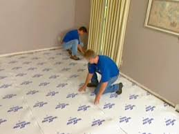 How To Remove Adhesive From Laminate Flooring How To Install Underlayment And Laminate Flooring Hgtv