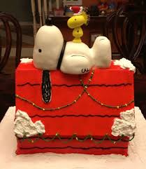 brown christmas snoopy dog house snoopy christmas doghouse cake between the pages
