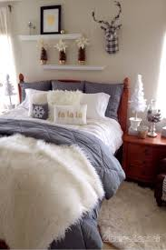 bedroom brown platform bed white matresses grey blanket brown
