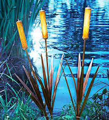 place these realistic cattail spikes in a garden of ornamental