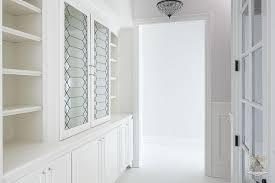 custom glass cabinet doors walk in closet with leaded glass cabinet doors transitional closet