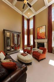 Living Room Colors With Brown Leather Furniture The Orange Tub Chairs Can Work With The Leather Sofa Down In The
