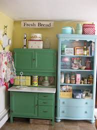 scenic green and blue vintage kitchen cabinet storage also open