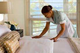 bed making maid making up hotel bed green traveler guides