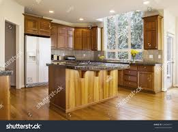 modern kitchen red oak wooden floors stock photo 124664911