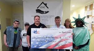 liberty tax makes donation to homeless coalition jessamine journal