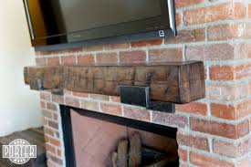 hand hewn pine mantel with custom steel brackets porter barn wood