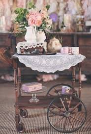 english cottage wooden with lace table runner serving cart with