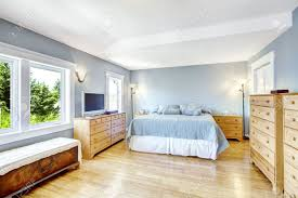 Bedroom Light Blue Images by Very Bright Bedroom In Light Blue Tones With Wooden Furniture