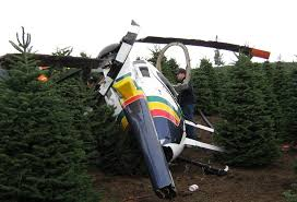 man injured after helicopter hauling christmas trees crashes in