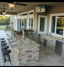 house plans with pools and outdoor kitchens a bit too fancy for us but something like this a lil smaller