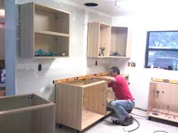support upper cabinets on a temporary rail then level and shim installing kitchen cabinets best home interior and architecture t 3947054862 installing inspiration