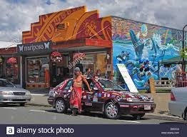 colourful hippy car and wall mural commercial street takaka colourful hippy car and wall mural commercial street takaka nelson region south island new zealand
