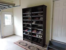 over large garage shoe storage with coat rack and red drawers