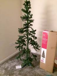 mother slams argos after christmas tree she bought fails to live