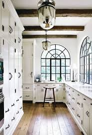 should baseboards match kitchen cabinets how to choose the right white or for your walls and