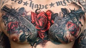 body art tattoo design chest tattoo guns and roses tattoo