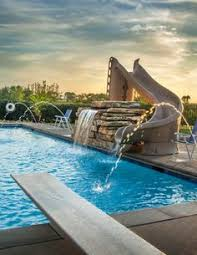 Backyard Pool With Slide - water slide and fountain swimming pool and retaining walls