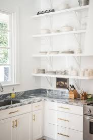 kitchen black and white granite with white cabinets contemporary