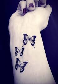 three butterfly tattoos on right wrist