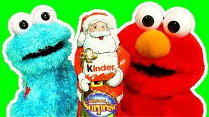 cookie monster eats kinder surprise santa elmo makes surprise toy
