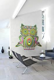 girlish wall mural idea painted in pink with little accent of colorful owl wall art idea to surprise white painted wall set in minimalist living room area