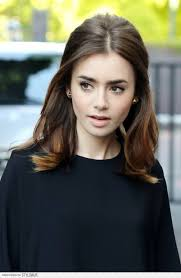 part down the middle hair style pretty ways to style a middle part lily collins hair lily collins