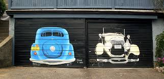 two car garage sqwabb garage mural seen in kitsilano just off west broadway the tires seem a little