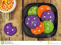 halloween wood background halloween monster eyeball cookies on plate against rustic wood