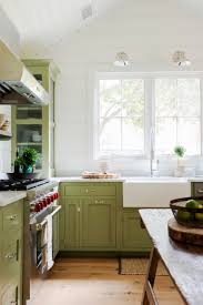 farmhouse restoration kitchen green cabinets marble counters