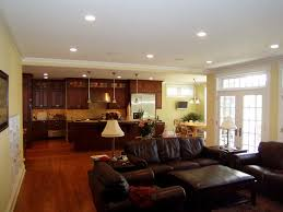 open kitchen design with living room interior and black sofa
