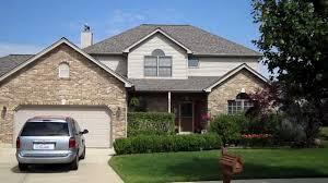 exterior design enchanting exterior home design with certainteed versetta stone with wood siding and certainteed landmark plus pittosporum tenuifolium for interesting exterior home design