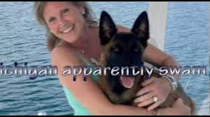 belgian sheepdog michigan dog swims over 6 miles to reunite with family after falling off