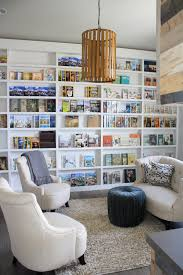a wall of shallow book shelves that allow the books to face
