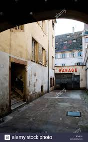 backyard in the centre of the old town with a garage stock photo
