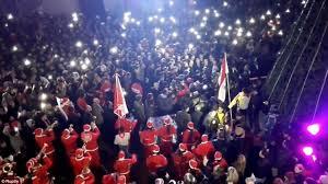 assad loyalists in aleppo dress up as santa and celebrate