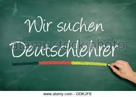 Seeking German German Handwritten Text On A Chalkboard With Grid Schule Beginnt