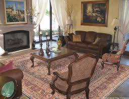a 150 year old laver kirman persian carpet adds timeless romance an antique persian oriental collectible laver kirman rug in a traditional living room