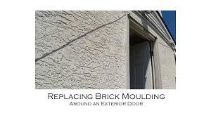 replacing brick moulding around an exterior door with resetting door