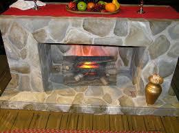 same time next year faux stone fireplace savard creative design