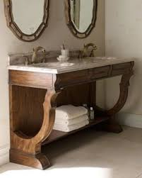 rustic wood bathroom vanity with open shelving and a drawer a