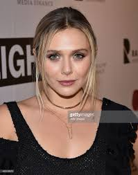 nashville hair show 2015 actress elizabeth olsen attends the premiere of i saw the light at picture id493139070